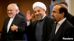 Iran's President Hassan Rouhani acknowledges members of the media on the sidelines of the Climate Summit at the U.N. headquarters in New York, September 23, 2014.