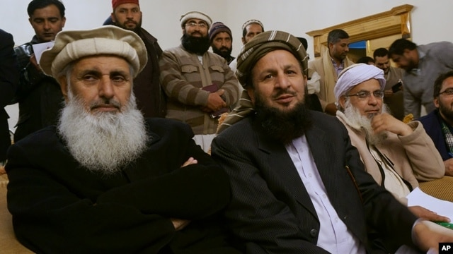 FILE - Pro-Taliban representatives attend a joint news conference after their talks with government representatives in Islamabad, Pakistan, Feb. 6, 2014.