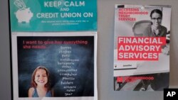 Fliers offering financial advising services to clients hang in a cubicle at the Neighborhood Trust Federal Credit Union in Washington Heights in New York, May 24, 2018.