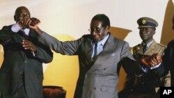 Morgan Tsvangirai e Robert Mugabe