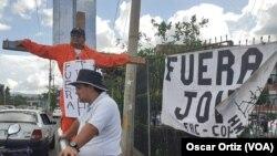 Hondureños reaccionan a las acusaciones por narcotráfico contra el presidente Juan Orlando Hernández, en medio del juicio que se sigue contra su hermano Tony Hernández en NY, EE.UU. VOA.