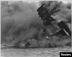FILE - A view of the USS ARIZONA burning after the Japanese attack on Pearl Harbor in Hawaii Dec. 7, 1941.