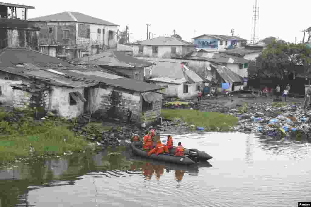 Liberian security forces patrol the waters around the Ebola quarantine area of West Point to stop residents crossing to the city center of Monrovia, Aug. 24, 2014.