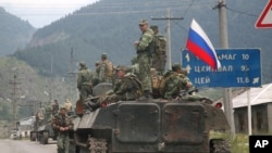 A column of Russian armored vehicles move through North Ossetia towards the breakaway republic of South Ossetia's capital Tskhinvali. (File)