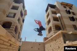 "Egyptian women in the Parkour Egypt ""PKE"" group train in Cairo, July 20, 2018. Picture taken July 20, 2018. REUTERS/Amr Abdallah Dalsh"