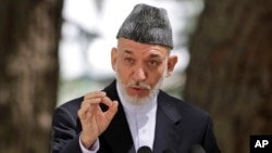 Afghan President Hamid Karzai speaks during a press conference at the presidential palace in Kabul, August 24, 2013.