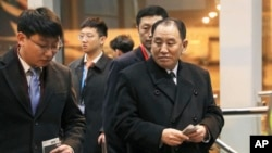 FILE - North Korean official Kim Yong Chol, right, prepares to leave the Beijing International Airport in Beijing, Jan. 17, 2019.
