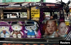 "FILE - A ""jeepney"" adorned with colorful pop culture characters is photographed on a main thoroughfare in Quezon City, metro Manila, Philippines, May 29, 2017."