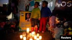 "Children sing ""Happy Birthday"" in front of messages of support outside the hospital where former South African President Nelson Mandela is being treated at, in Pretoria,July 17, 2013. Mandela turns 95 on July 18."