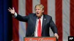 FILE - Republican presidential candidate, businessman Donald Trump addresses supporters at a campaign rally.
