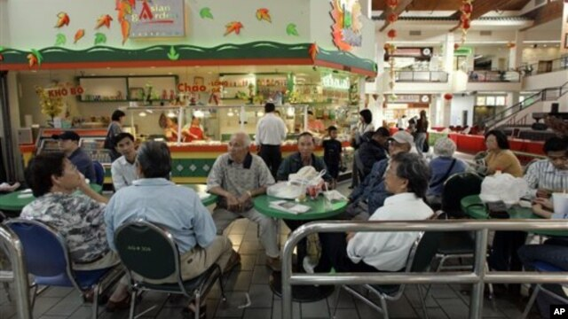 FILE - A group of Vietnamese Americans eat lunch at the Asian Garden mall in the Little Saigon section of Westminster, California.