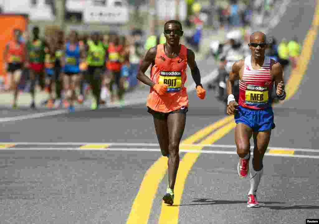 Boston Marathon elite runners Josphat Boit (L) and Meb Keflezighi (R) race to the finish line during the 2014 Boston Marathon in Massachusets, USA. (USA Today Sports)