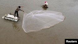 A man casts a fishing net on the Mekong riverbank in Phnom Penh, Cambodia. (File)