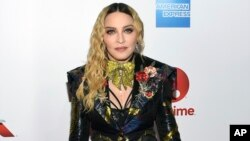 Madonna attends the 11th annual Billboard Women in Music honors at Pier 36, Dec. 9, 2016, in New York.