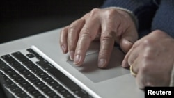 A cyber warfare expert works on his laptop computer in Charlotte, North Carolina, December 1, 2011.