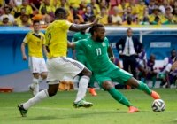 Ivory Coast's Didier Drogba, right, has a shot during the group C World Cup soccer match between Colombia and Ivory Coast at the Estadio Nacional in Brasilia, Brazil, Thursday, June 19, 2014.
