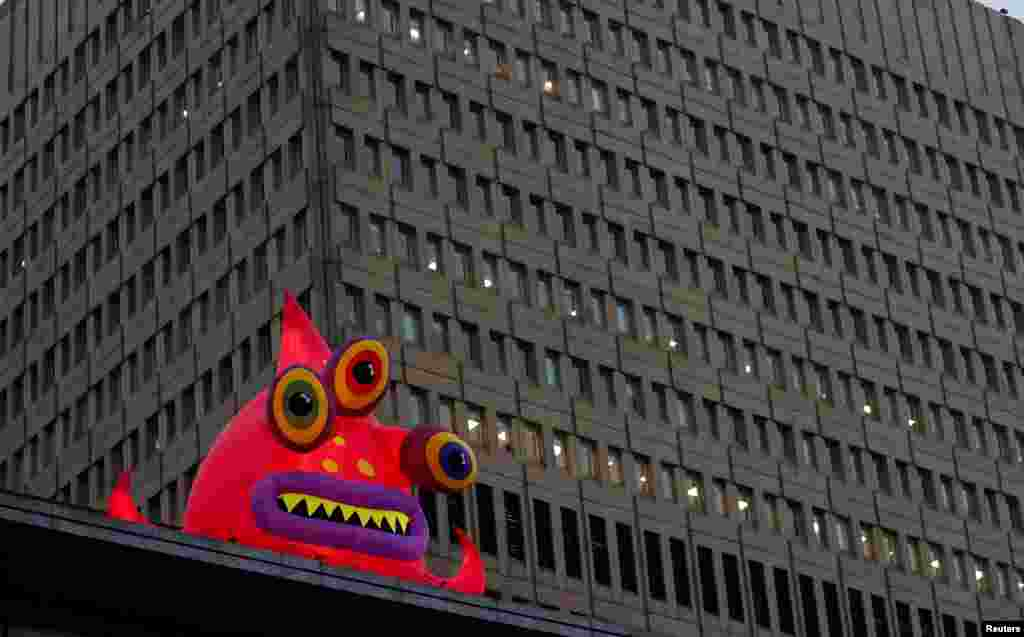 A giant inflatable monster, one of a collection of monsters that have appeared to mark Halloween, is seen in front of an office block in Manchester, Britain.