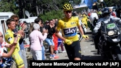 Britain's Chris Froome runs after he crashed at the end of the twelfth stage of the Tour de France cycling race.