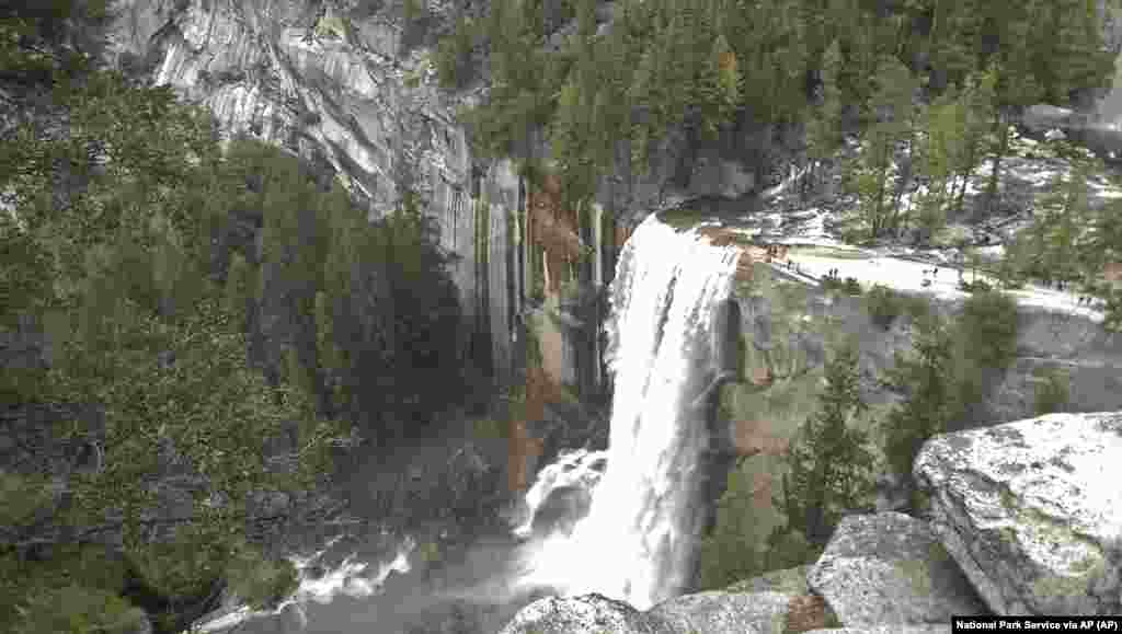Water plunges 300 feet over Vernal Fall onto the Merced River in Yosemite National Park, California.