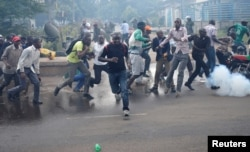 FILE - Protesters, rallying against what they see as a biased electoral commission, run away from police during clashes in Nairobi, Kenya, May 16, 2016. The country is scheduled to hold presidential and parliamentary elections in August 2017.