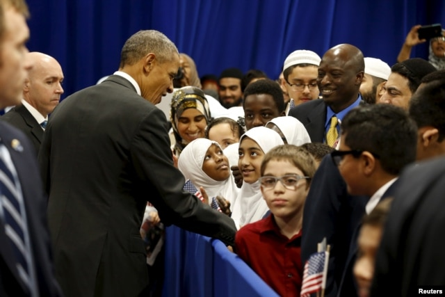 President Barack Obama greets students after his remarks at the Islamic Society of Baltimore mosque in Catonsville, Maryland, Feb. 3, 2016.