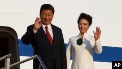 Presiden China Xi Jinping dan istrinya Peng Liyuan (5/10).