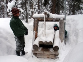 Wildlife biologists John Rohrer and Scott Fitkin check a wolverine trap in Washington's North Cascades.