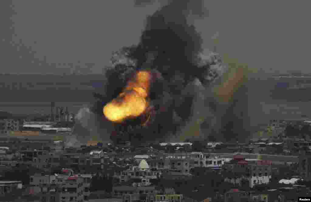 Smoke and flames are seen following what police said was an Israeli air strike in Rafah in the southern Gaza Strip. Israel bombarded dozens of targets in the Gaza Strip, stepping up what it said might become a long-term offensive against Islamist Hamas.
