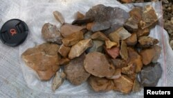 Surface-collected stone artifacts that were found lying scattered on the gravelly surface near Talepu on the Indonesian island of Sulawesi, are pictured in this undated handout photo, Jan. 13, 2016.