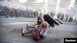 FILE - Riot police use a water cannon to disperse LGBT rights activist before a gay pride parade in central Istanbul, Turkey, June 28, 2015.
