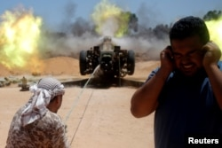Libyan forces allied with the U.N.-backed government fire a 122 MM artillery towards Islamic State fighters positions in Sirte, Libya, July 24, 2016.