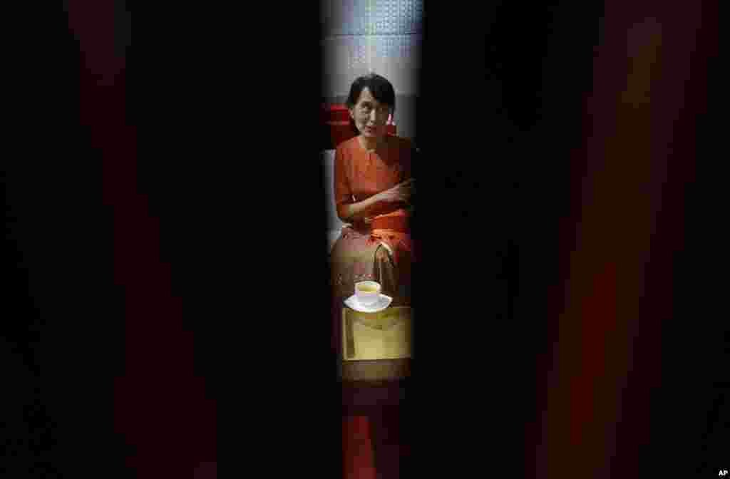 Burma's pro-democracy leader Aung San Suu Kyi has a cup of tea at the VIP lounge of Rangoon's airport as she waits for her flight to Bangkok, Thailand, May 29, 2012.