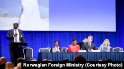 South Sudanese Foreign Minister Barnaba Marial Benjamin addresses a donor conference for South Sudan in Oslo, Norway, in May 2014.