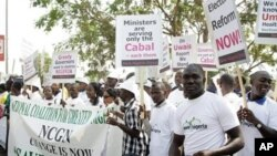 Demonstrators display banners and placards as they participate in a protest in Abuja on March 10, 2010. Around 5,000 Nigerian activists staged a march to demand the sacking of the cabinet and a public appearance by ailing President Umaru Yar'Adua, two wee
