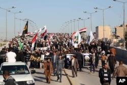 伊拉克什叶派穆斯林在巴格达抗议沙特阿拉伯处决尼姆尔