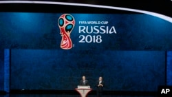 FIFA President Sepp Blatter, right, and Russian President Vladimir Putin open the preliminary draw for the 2018 soccer World Cup in Konstantin Palace in St. Petersburg, Russia, Saturday, July 25, 2015. (AP Photo/Ivan Sekretarev)
