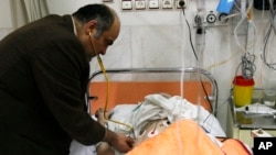 FILE - Dr. Ciamak Morsathegh, head of the Tehran Jewish Committee, visits a patient at the Dr. Sapir Charity Hospital, owned by the Iranian Jewish community, in Tehran, Dec. 26, 2007.