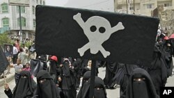 Women march during a demonstration in the southern city of Taiz demanding the ouster of Yemen's President Ali Abdullah Saleh, July 17, 2011