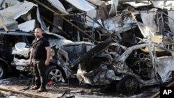 Hiện trường 1 vụ nổ bom xe tại Baghdad, Iraq, 17/11/2014.