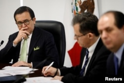 FILE - Mexico's Economy Minister Ildefonso Guajardo listens during the presentation of Mexico's negotiating team for the renewal of the North American Free Trade Agreement (NAFTA) in Mexico City, Mexico, Aug. 2, 2017.