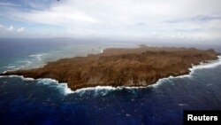 An aerial view of a remote island of Suluan, Samar, devastated by Typhoon Haiyan in central Philippines, Nov. 20, 2013.