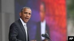 Le président Barack Obama prononce un discours lors de la cérémonie d'ouverture du Musée national Smithsonian d'histoire et de la culture afro-américaine sur le National Mall à Washington, DC, 24 septembre 2016.