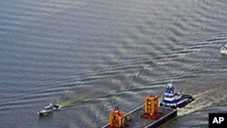 The Blow Out Preventer (BOP) from the Deepwater Horizon heads up the Mississippi River in route to a NASA facility in Michoud, 11 Sep 2010