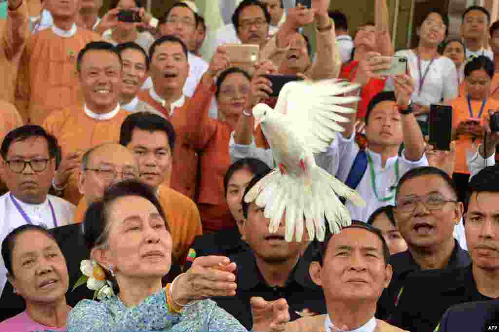 Myanmar State Counsellor Aung San Suu Kyi releases a dove during a celebration marking her 73rd birthday at the parliament house in Naypyidaw.