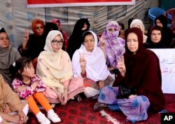 FILE - Pakistani lawyer Jalila Haider, center, from the Hazara Shiite minority community participates in a hunger strike with others at a camp in Quetta, April 30, 2018.