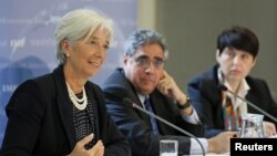 International Monetary Fund managing director Christine Lagarde (L) speaks at a news conference at the Treasury in London, May 22, 2012.