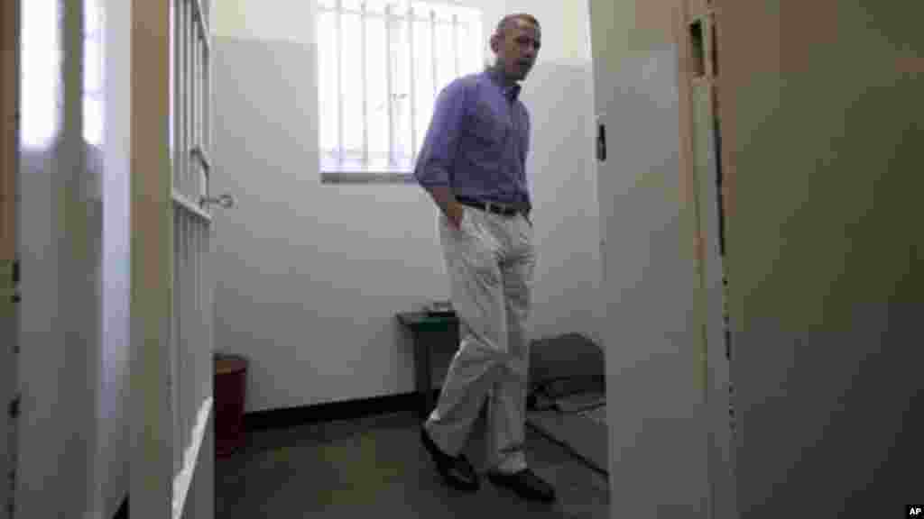 U.S. President Barack Obama looks out from Section B, prison cell No. 5, on Robben Island, South Africa.