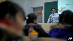In this Tuesday, Dec. 1, 2009 photo, economist Ilham Tohti speaks to students at the Central Nationalities University in Beijing, China. He has been under arrest dozens of times over the past decade for criticizing how China runs his homeland and treats his people.