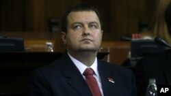 Serbia's prime minister-designate, Ivica Dacic, front, looks on during a parliamentary session in Belgrade, July 26, 2012.
