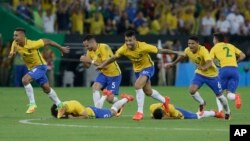 Brazil's players react as Neymar scores the decisive penalty kick during the final match of the men's Olympic soccer tournament at Maracana Stadium in Rio de Janeiro, Brazil, Aug. 20, 2016.